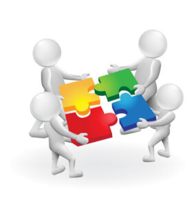 Omini bianchi costruiscono puzzle collaborazione